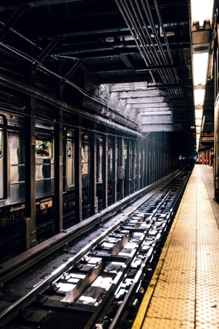 Sunlight streaking through grate onto subway tracks, The Initiation
